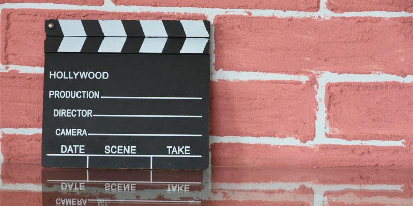 Clapper Board against Brick Wall