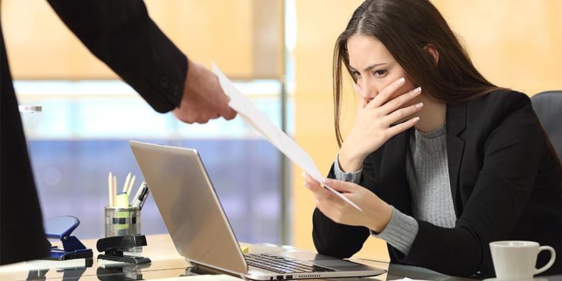 Worried businesswoman receiving notification