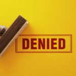 Denied red stamp on yellow background