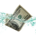 $100 Dollar Bill floating in water