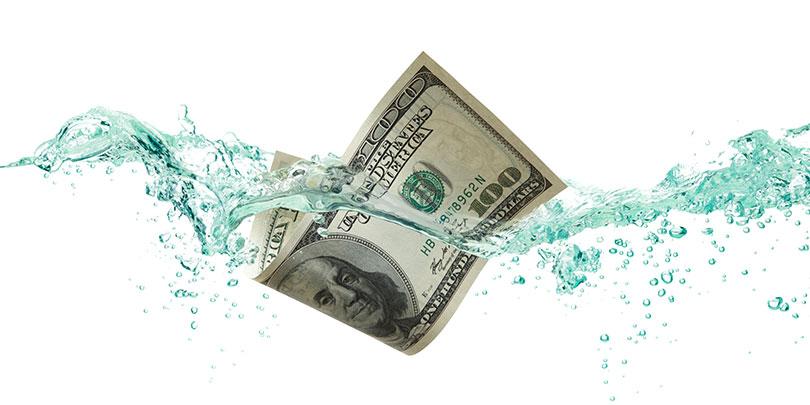 $100 Dollar Bill floating in water