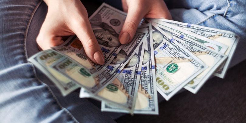 Handing money over in an offering