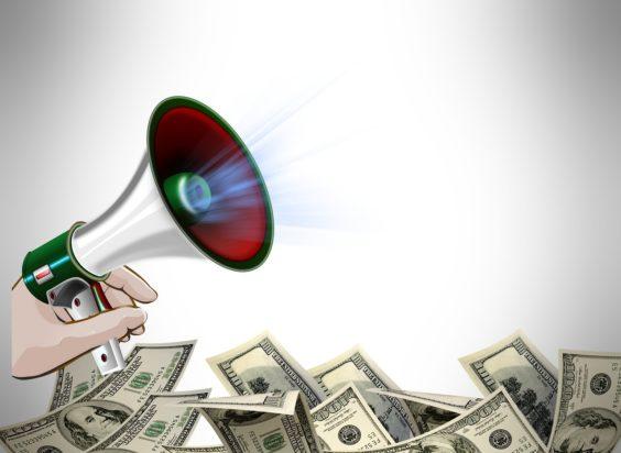 Photo of a megaphone and dollar bills