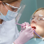 Dentist wearing a mask due to COVID-19